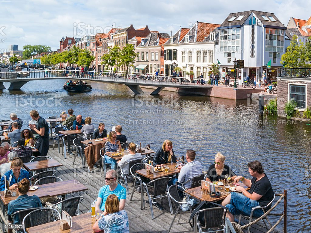 People and bridge over Rhine canal, Leiden, Netherlands stock photo