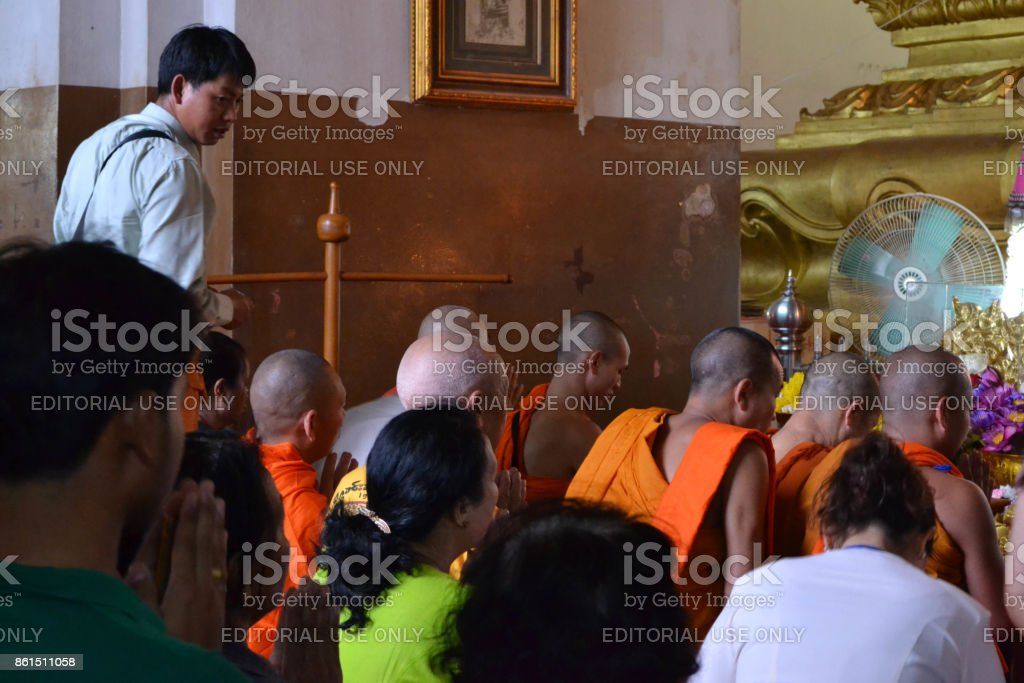 People and Buddhist monks were praying at one temple. stock photo