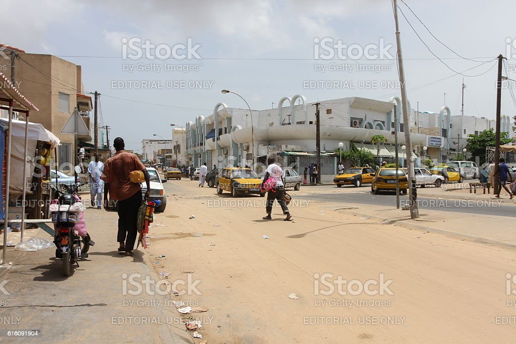 People and cars in Dakar in Senegal stock photo