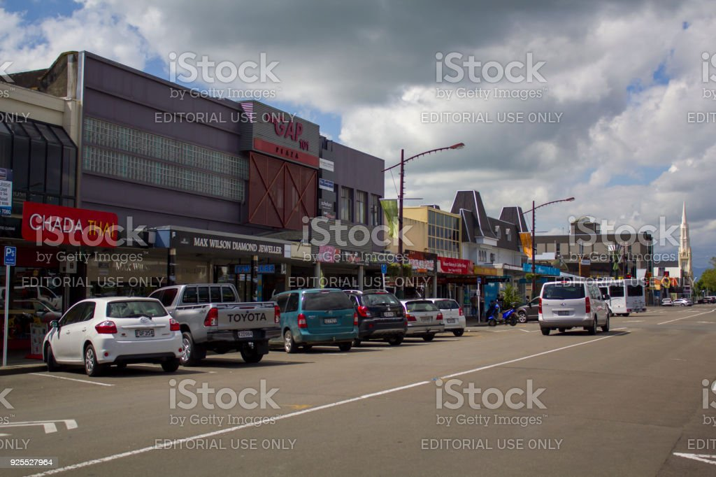 People and cars on a street in the afternoon, New Zealand stock photo