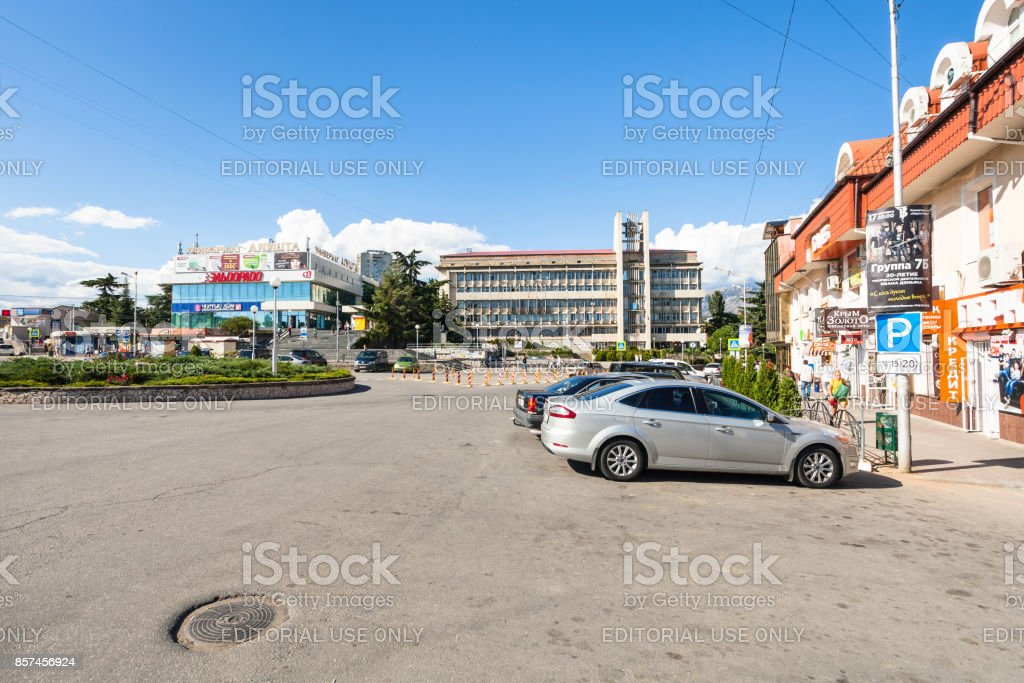 people and cars on Sovetskaya Square in Alushta stock photo
