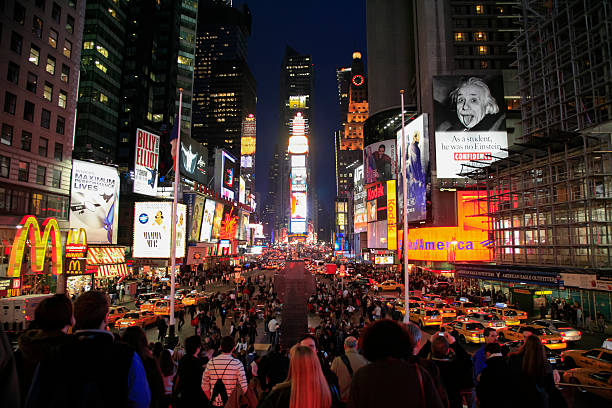 people and lights at night, time square, new york city - mamma mia stock photos and pictures