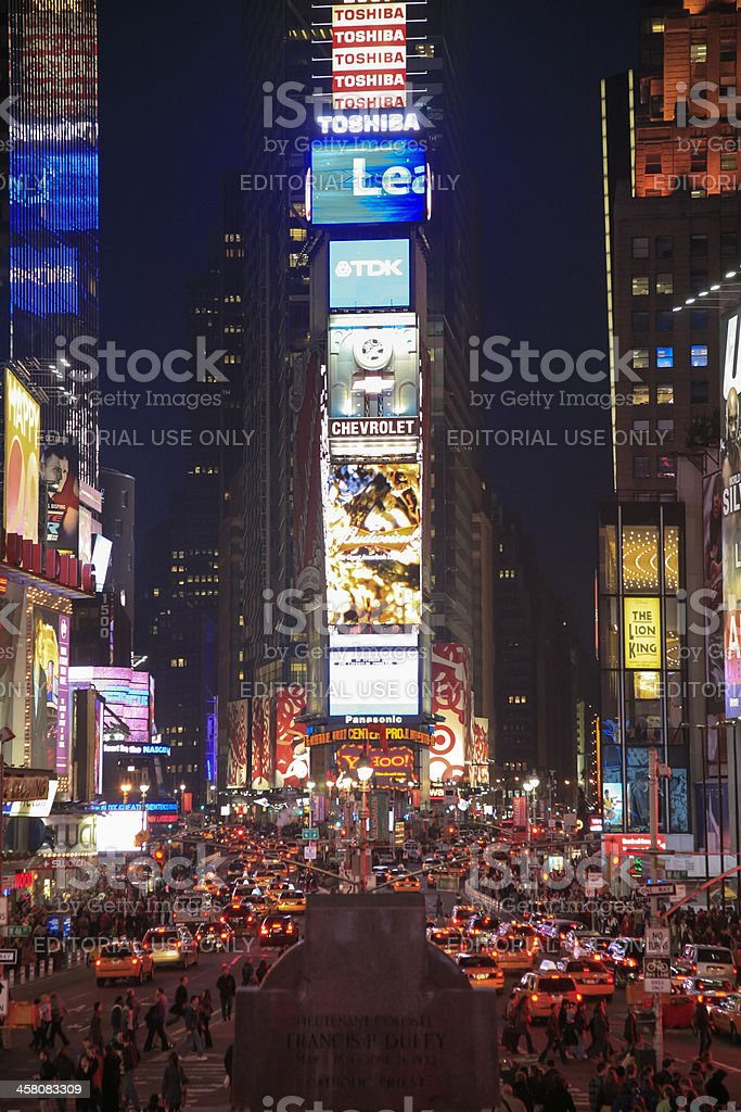 People and lights at night, Time Square, New York City royalty-free stock photo