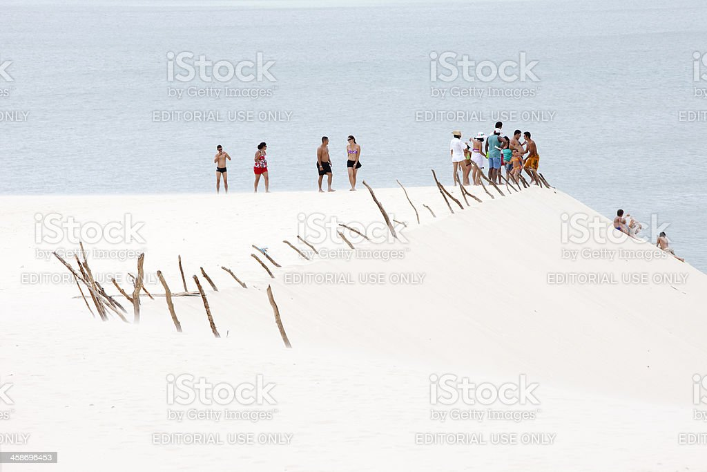People and Sand Dunes in Jericoacoara, Brazil stock photo