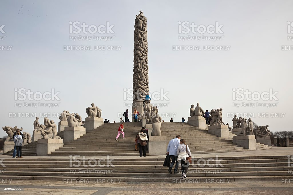 People and sculptures in early spring. stock photo