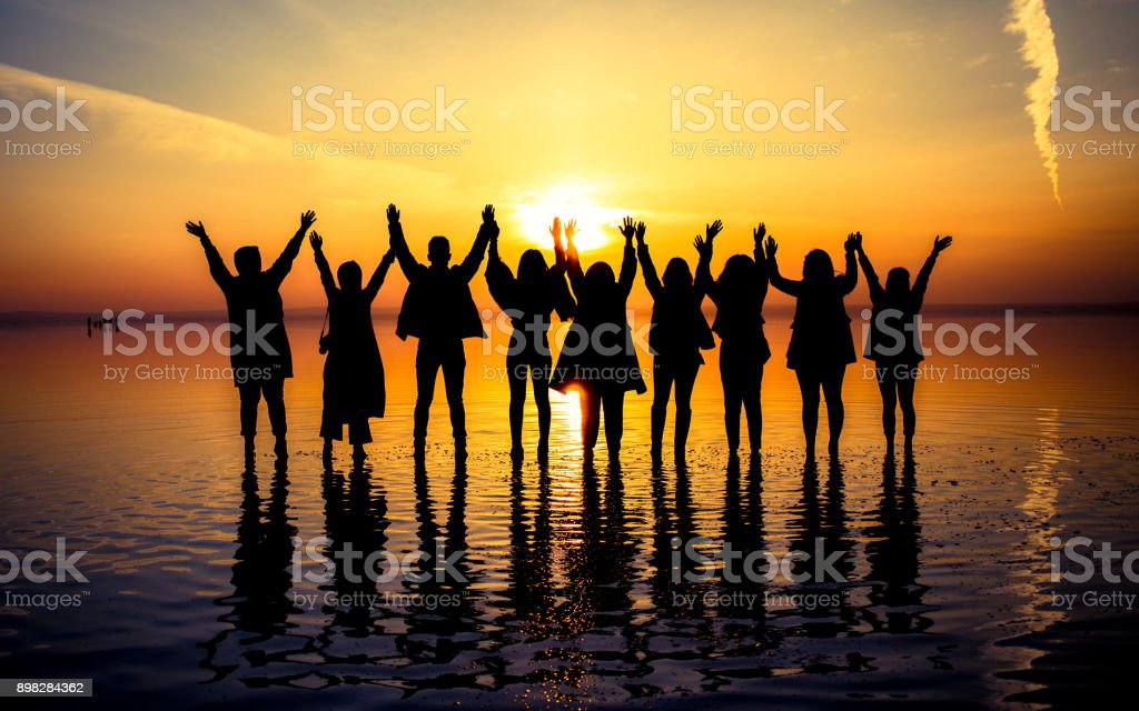 People and sunsets stock photo