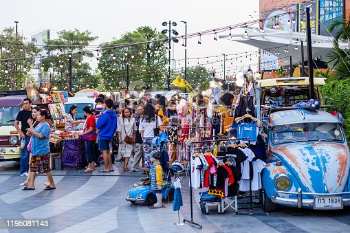 Samut Sakhon, Thailand - 15 December 2019:People and Tourist buying food and drinks at outdoor street food night market in the Park. Market Stalls. Outdoor market. Food Event.Food Fair. Festival.Flea Market.Bazaar