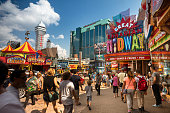 Niagara Falls, Ontario, Canada - August 1, 2017:  Tourists walk along the main downtown shopping and entertainment district of Niagara Falls Ontario