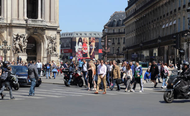 People and traffic in Paris, France stock photo