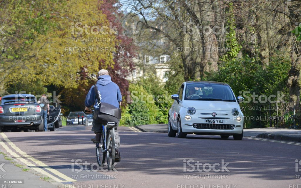 People and Traffic Pass through Victoria Park in Bath England stock photo