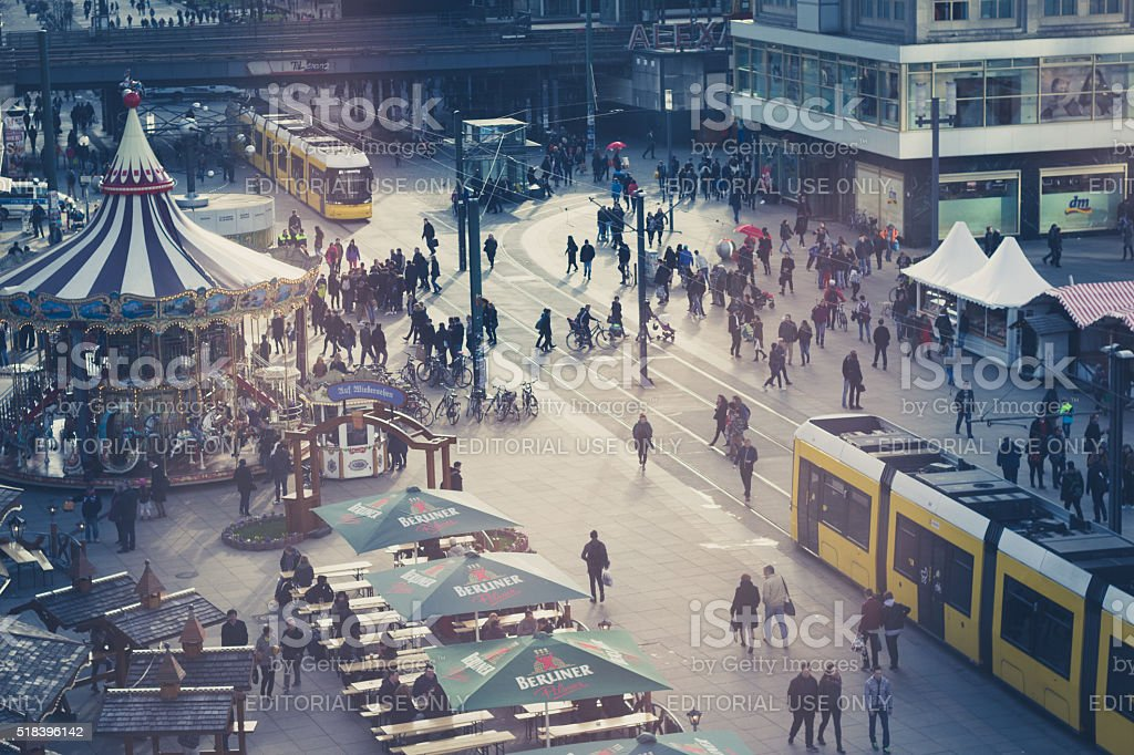 People and trains at Alexanderplatz in berlin stock photo