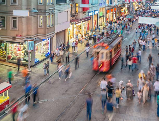 people and tram on the istiklal street - istiklal avenue bildbanksfoton och bilder