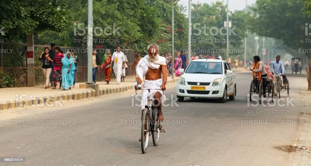 people and Transport on the roads of India. India, Vrindavan, November 2016 royalty-free stock photo