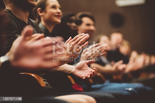483876497 istock photo People applauding in the theater 1207071139