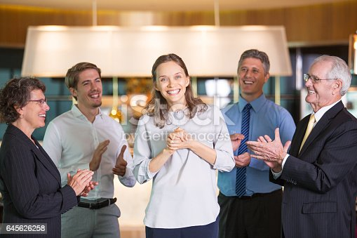istock People Applauding to Happy Young Female Colleague 645626258