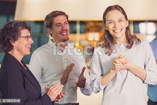 istock People Applauding to Happy Young Female Colleague 823830548