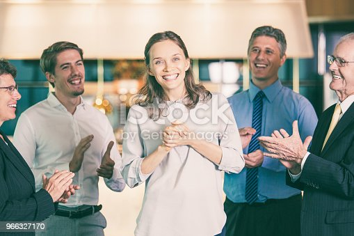 878220300 istock photo People Applauding to Happy Young Female Colleague 966327170
