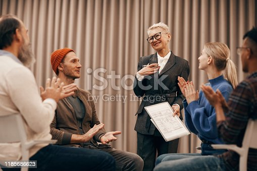 640177838 istock photo People applauding to woman 1185686623
