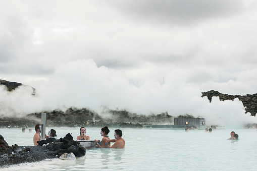 People Applying Silica To Bodies At The Blue Lagoon Stock