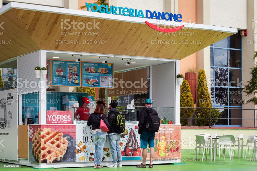 People ar buying ice cream in kiosk located at Tibidabo park in Barcelona, Spain