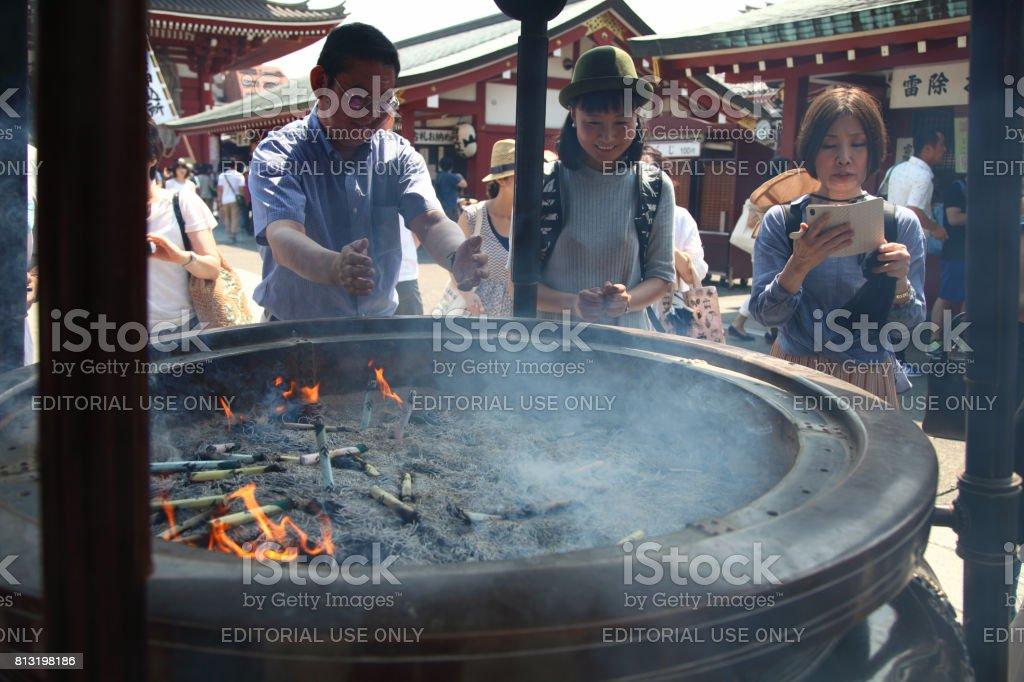 People are bathing smoke at Sensoji Temple, Asakusa stock photo