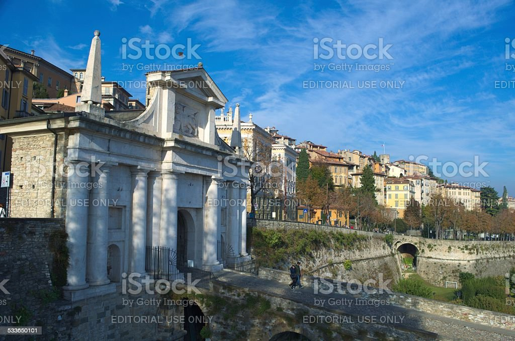 People are coming to the porta san giacomo in bergamo. stock photo