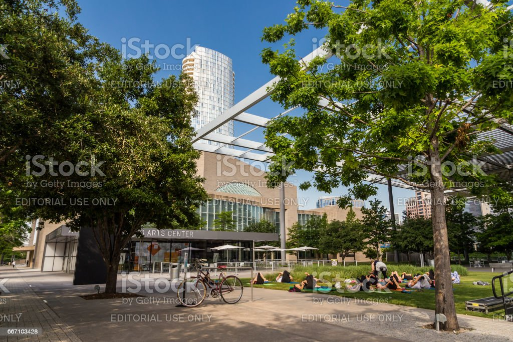 People are doing yoga in park in Art district downtown Dallas, TX stock photo