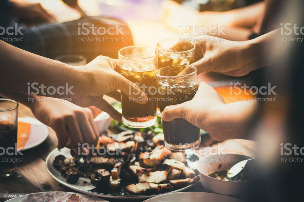 people are eating food ,drinking beverage together in party ,restaurant stock photo