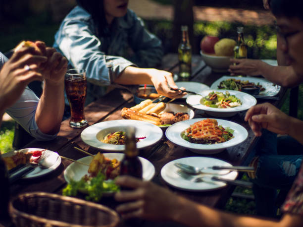 People are eating on vacation. They eat outside the house. stock photo