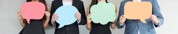 People are holding colorful Speech Bubbles. Group of Business People holding blank colorful Speech Bubbles. Banners, Panoramic, Web. questionnaire stock pictures, royalty-free photos & images