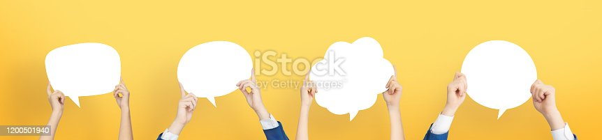 istock People are holding colorful white Bubbles. 1200501940