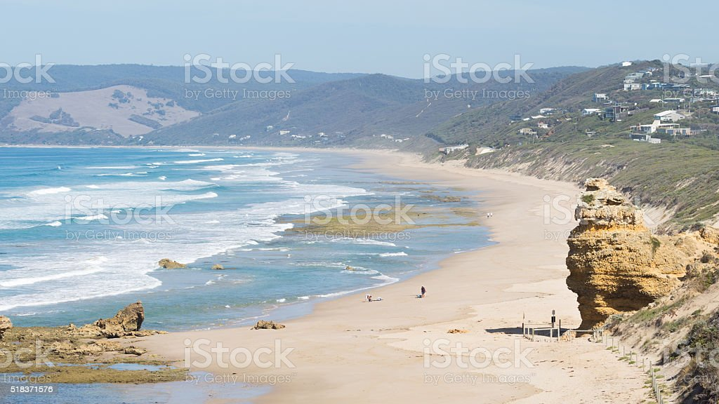 people are not recognizable on the shore stock photo