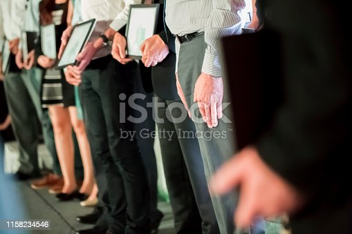 Unrecognizable people are receiving awards and diplomas, selective focus