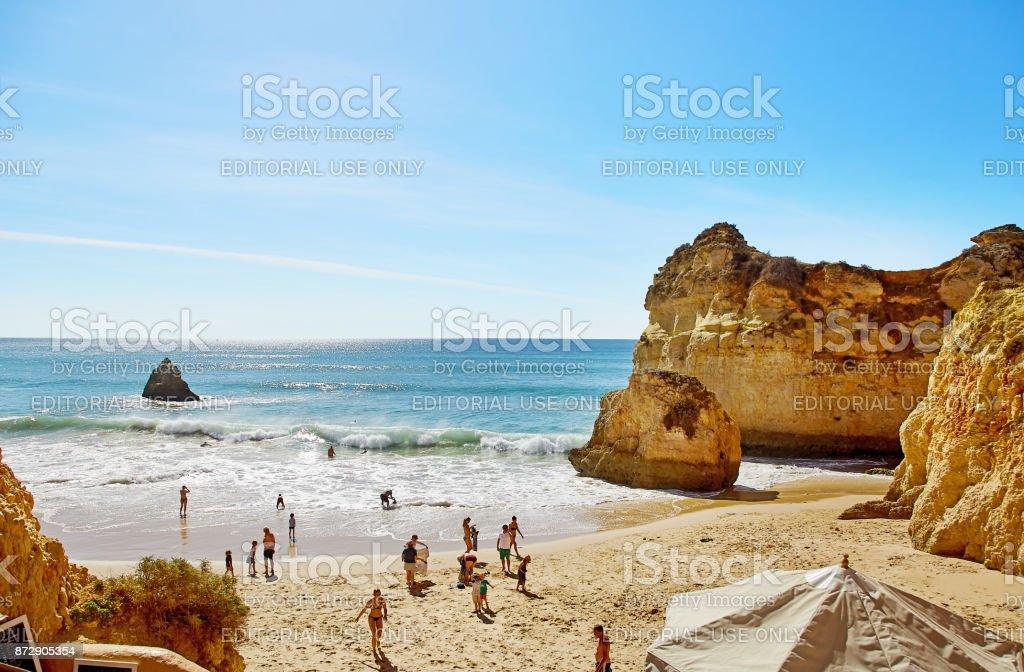 People are swimming and sunbathing at beach of Algarve, Portugal - fotografia de stock