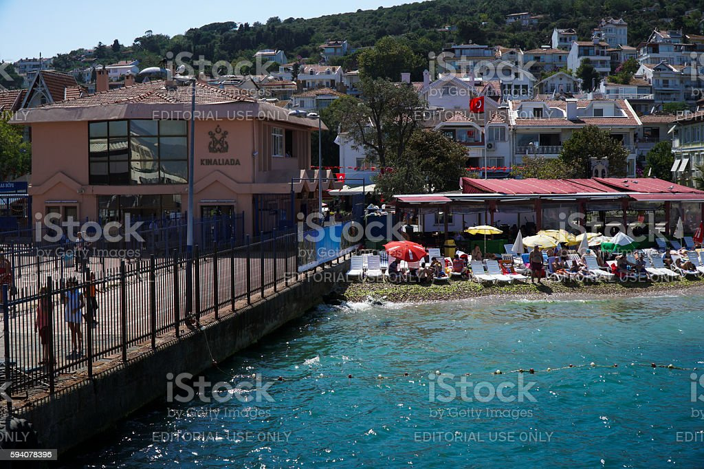 People are Swimming and Sunbathing At The Kinali Ada Beach stock photo