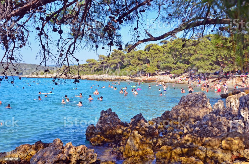 People are swimming in a turquoise sea. stock photo
