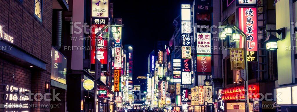 People are traveling in Shinjuku Shopping district. stock photo