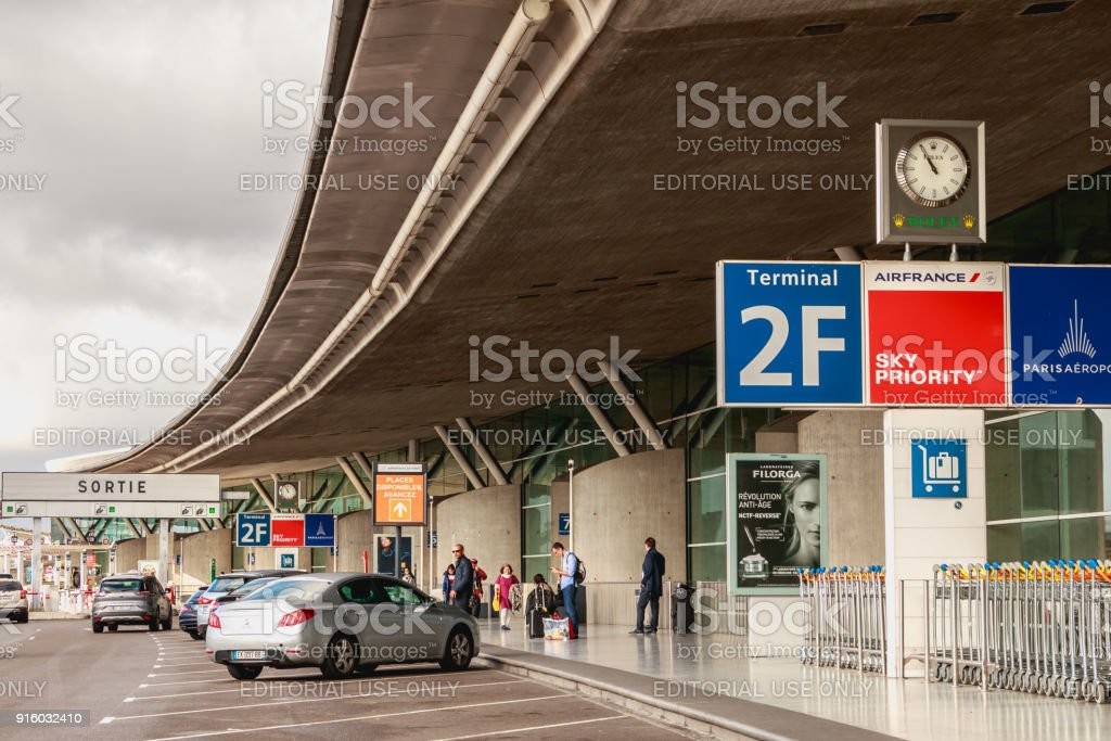 people are waiting outside the 2F terminal at Roissy Charles de Gaulle stock photo