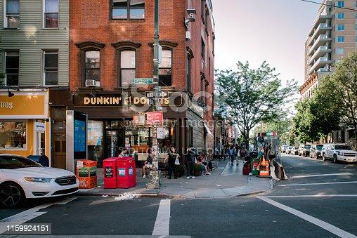 Williamsburg, Brooklyn, United States - June 23 , 2019: People are walking along Bedford Avenue in Williamsburg, Brooklyn on a beautiful weekend afternoon.