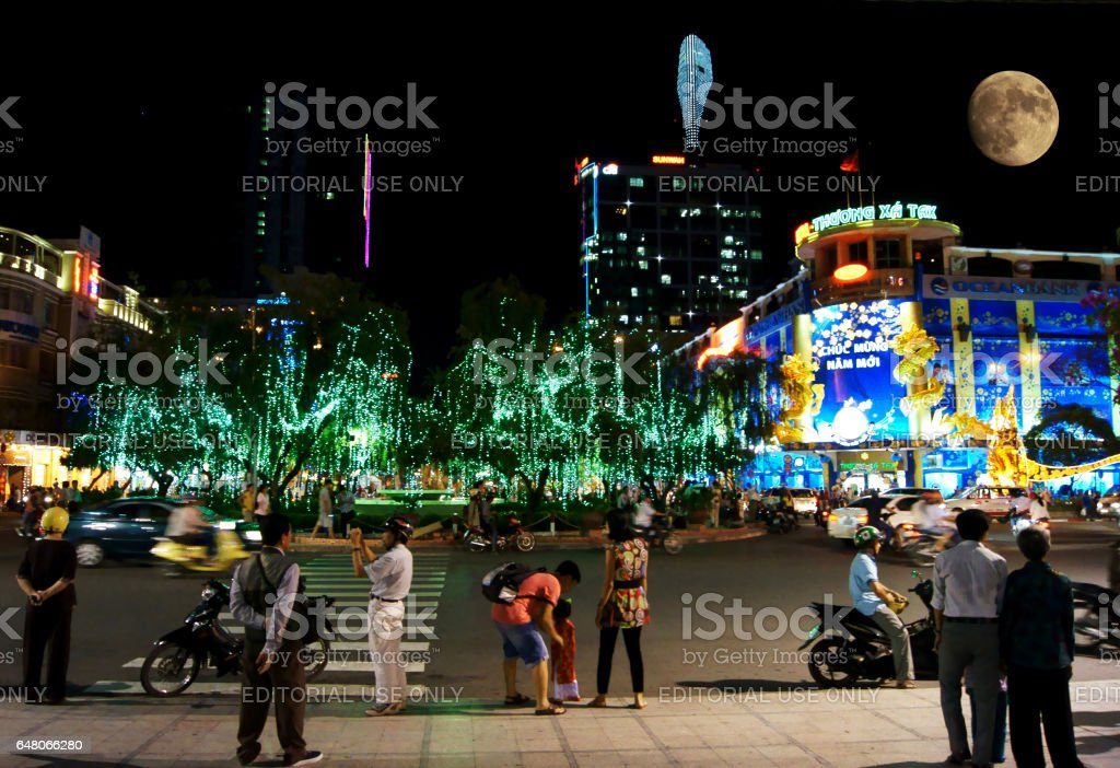 People are walking at night in Ho Chi Minh City stock photo