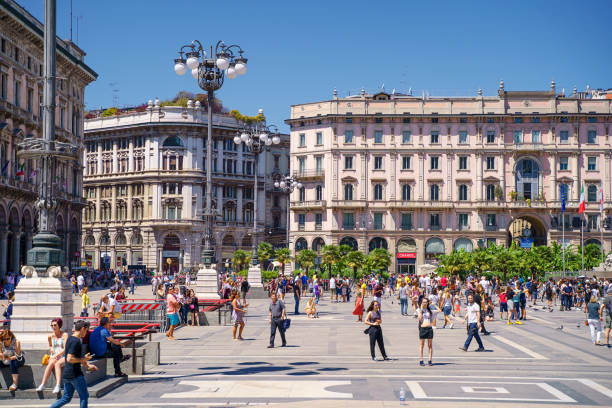 People are walking at Piazza del Duomo square in Milan city, Italy stock photo