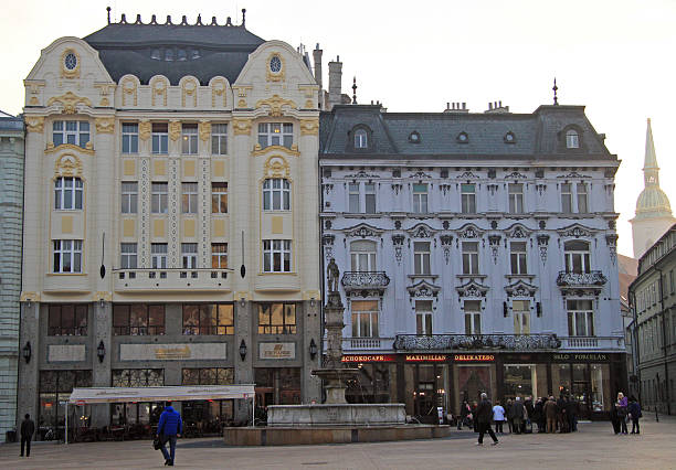 people are walking by the main square in bratislava, slovakia - maximilian stock-fotos und bilder