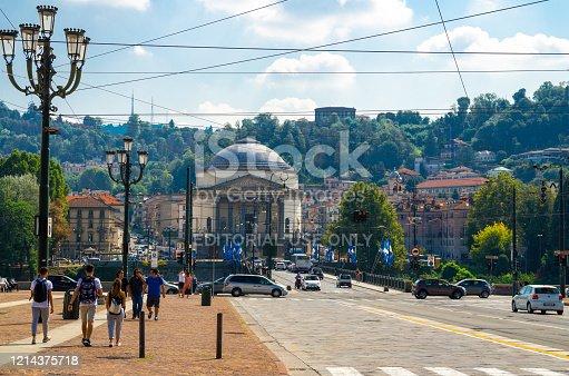 Turin, Italy, September 10, 2018: people are walking down Piazza Vittorio Veneto square, view of Catholic Parish Church Chiesa Gran Madre Di Dio and Ponte Vittorio Emanuele I bridge over Po river