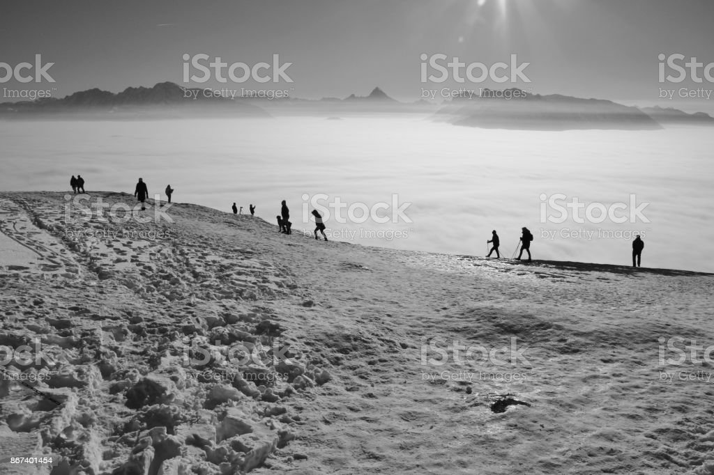 People are walking in the snow, on the top of the mountain Gaisberg, Austria. stock photo