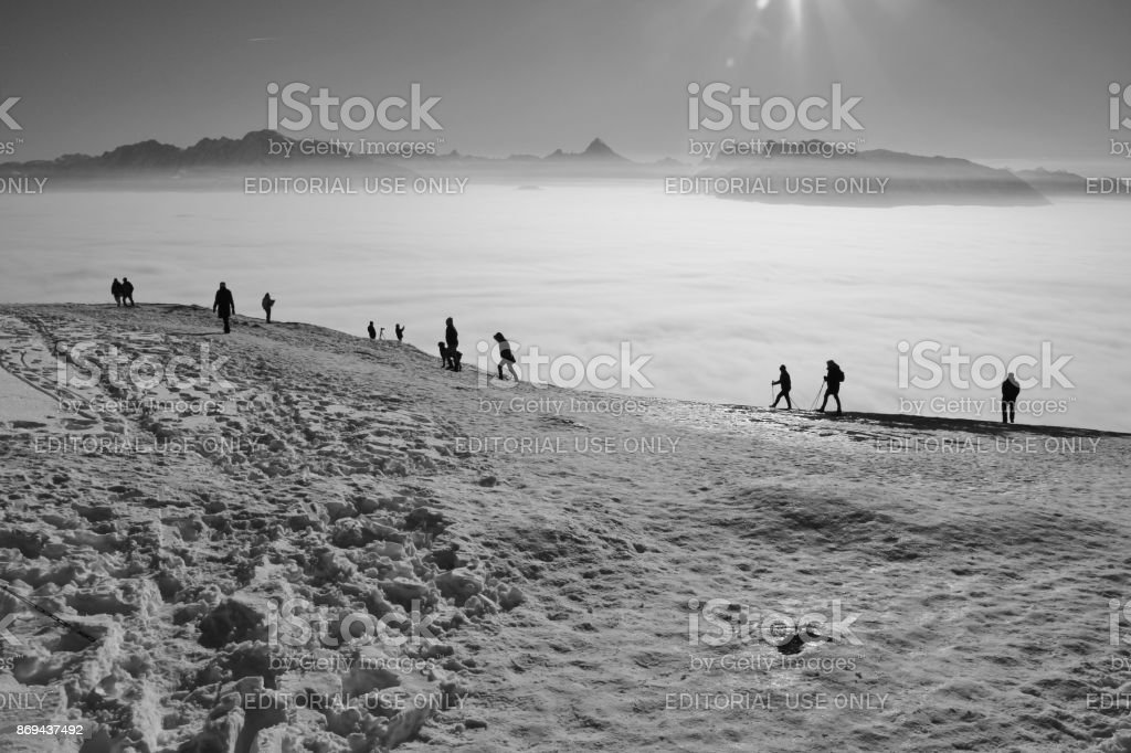 People are walking in the snow, on the top of the mountain Gaisberg, Salzburg, Austria. stock photo
