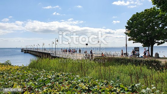 istock People are walking on the pier on a sunny day in Gdynia Orłowo, Poland 1330936748