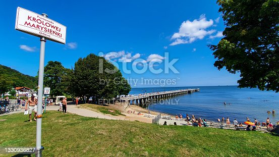 istock People are walking on the pier on a sunny day in Gdynia Orłowo, Poland 1330936827