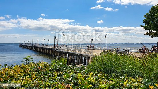 istock People are walking on the pier on a sunny day in Gdynia Orłowo, Poland 1330936943