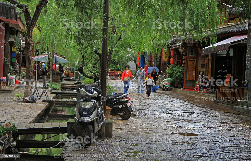 people are walking on the street in Lijiang, China stock photo