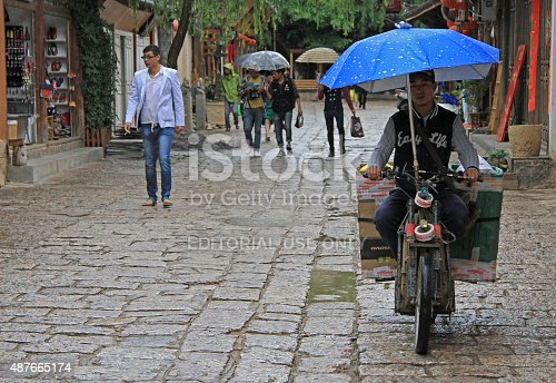 istock people are walking on the street in Lijiang, China 487665174